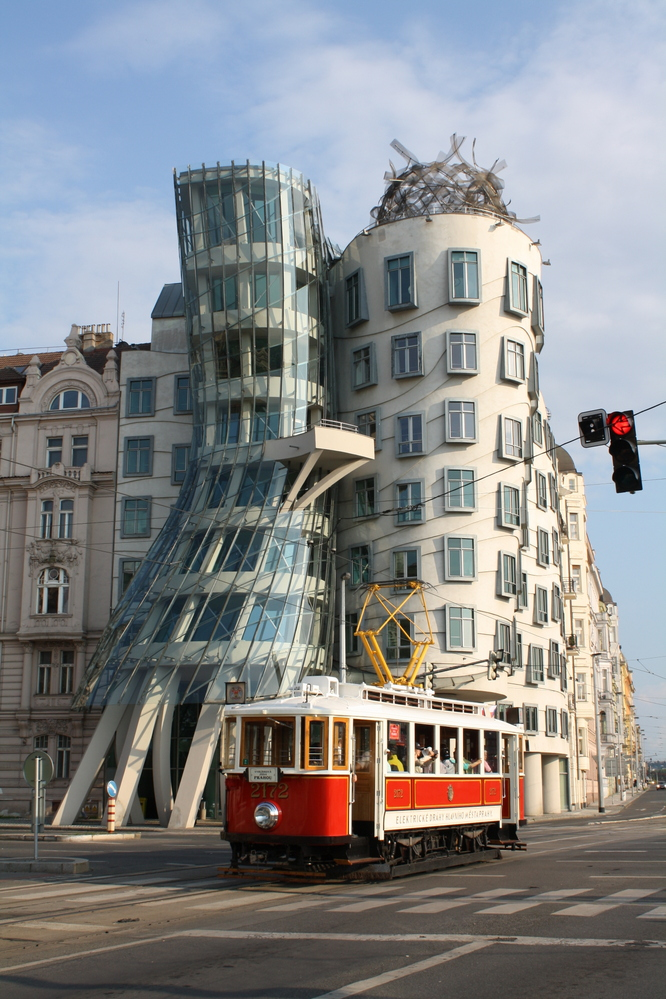 dancing house in prague with red tram nzmuse