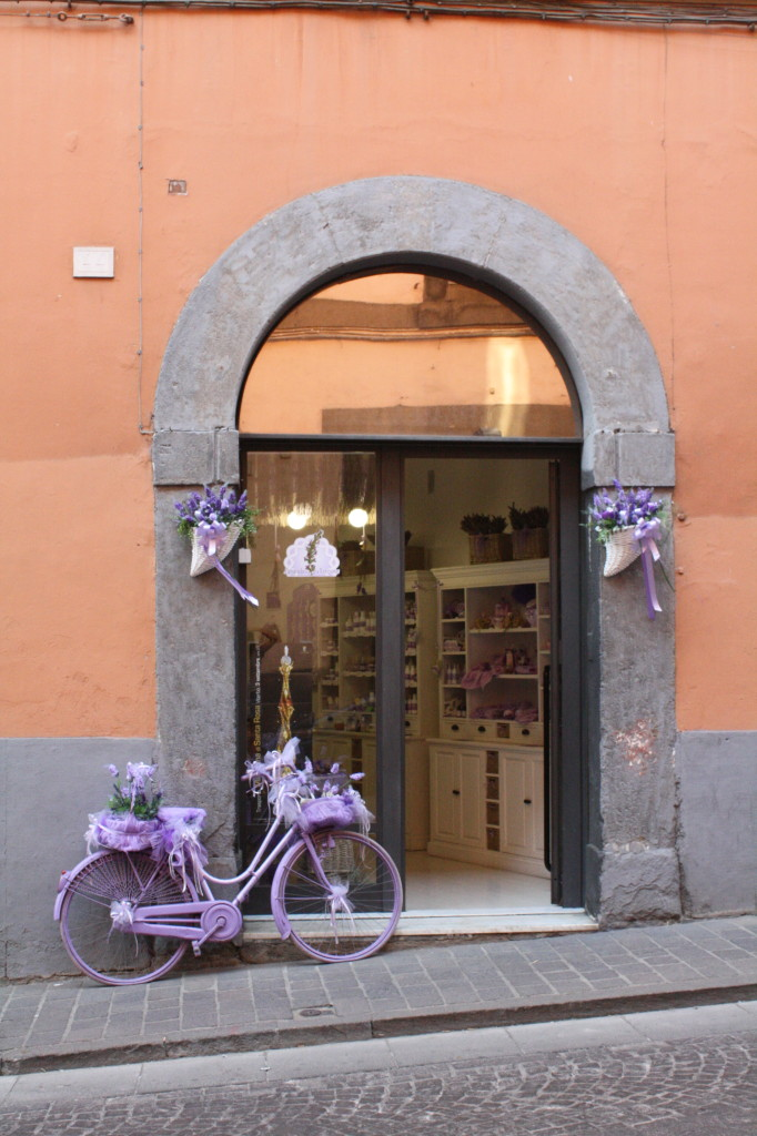 purple bike orange building viterbo