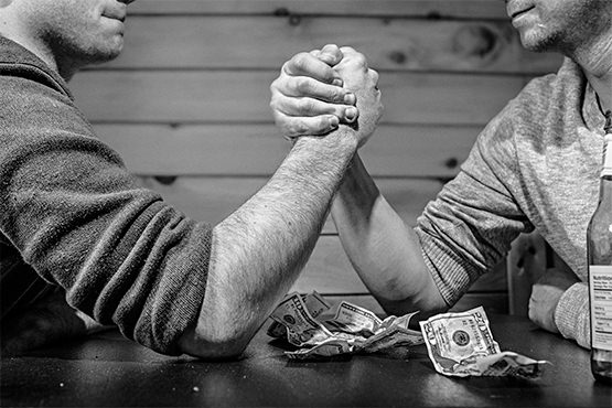 Arm wrestling - money woesArm wrestling - money woes